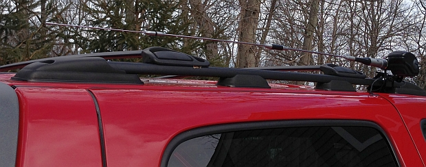 Antenna lowered prior to entering garage